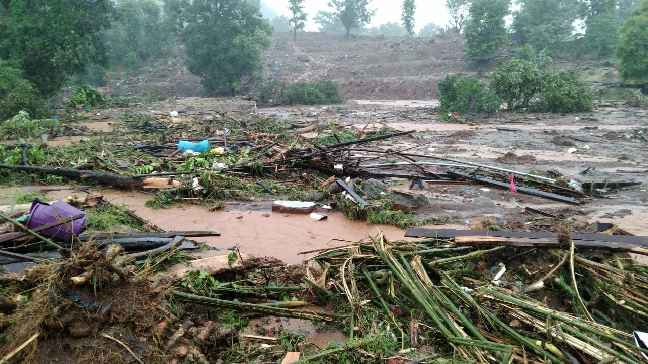 This handout picture taken on July 23, 2021 and released by the National Disaster Response Force (NDRF) shows debris of houses in Taliye village after a landslide in Mahad of Raigad district of Maharashtra. (AFP)