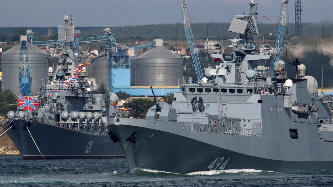 The Russian Navy's guided missile cruiser Moskva and frigate Admiral Grigorovich are seen ahead of the Navy Day parade in the Black Sea port of Sevastopol, Crimea July 23, 2021. (Reuters)