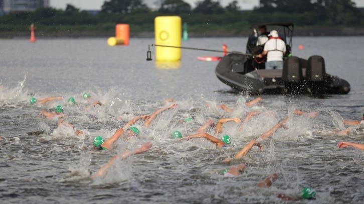 Camera boat nearly runs over Olympic swimmers in triathlon false start