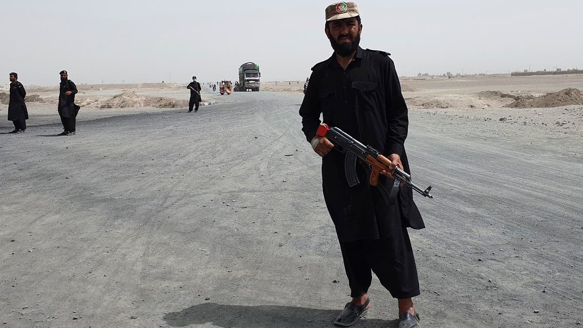 Pakistani paramilitary soldiers stand guard near the Pakistan Afghan border crossing following fighting between Afghan security forces and Taliban in SpinBoldak border area, in Chaman, Pakistan, on July 16, 2021. (AP)