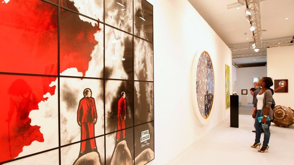 Visitors look at pieces of artwork during the Abu Dhabi Art Fair at Manarat al Saadiyat in Saadiyat Islands, Abu Dhabi. (File photo: Reuters)