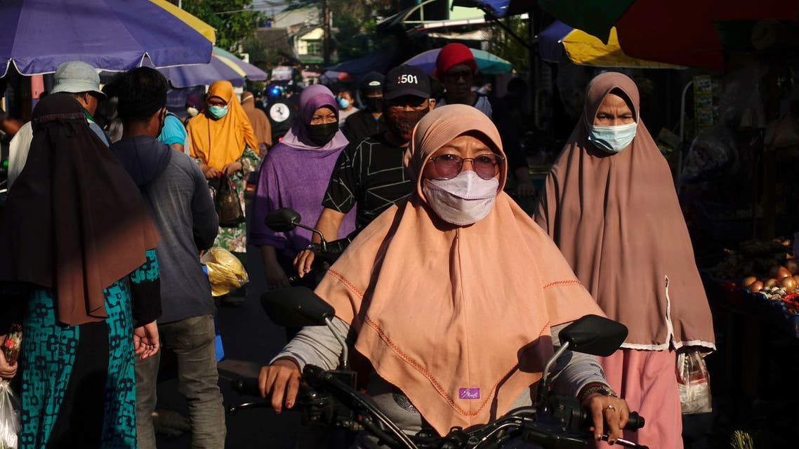 People wearing protective masks are pictured as they shop at a traditional market as government eases the emergency restrictions amid the coronavirus disease (COVID-19) pandemic in the capital of Jakarta, Indonesia, July 26, 2021. (Reuters)