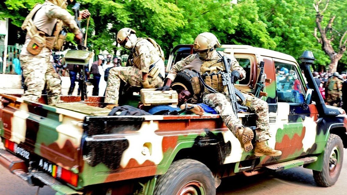 An assailant who attempted to stab Mali's interim president Colonel Assimi Goita, is seen lying in an army vehicle after he was arrested in Bamako. (Reuters)