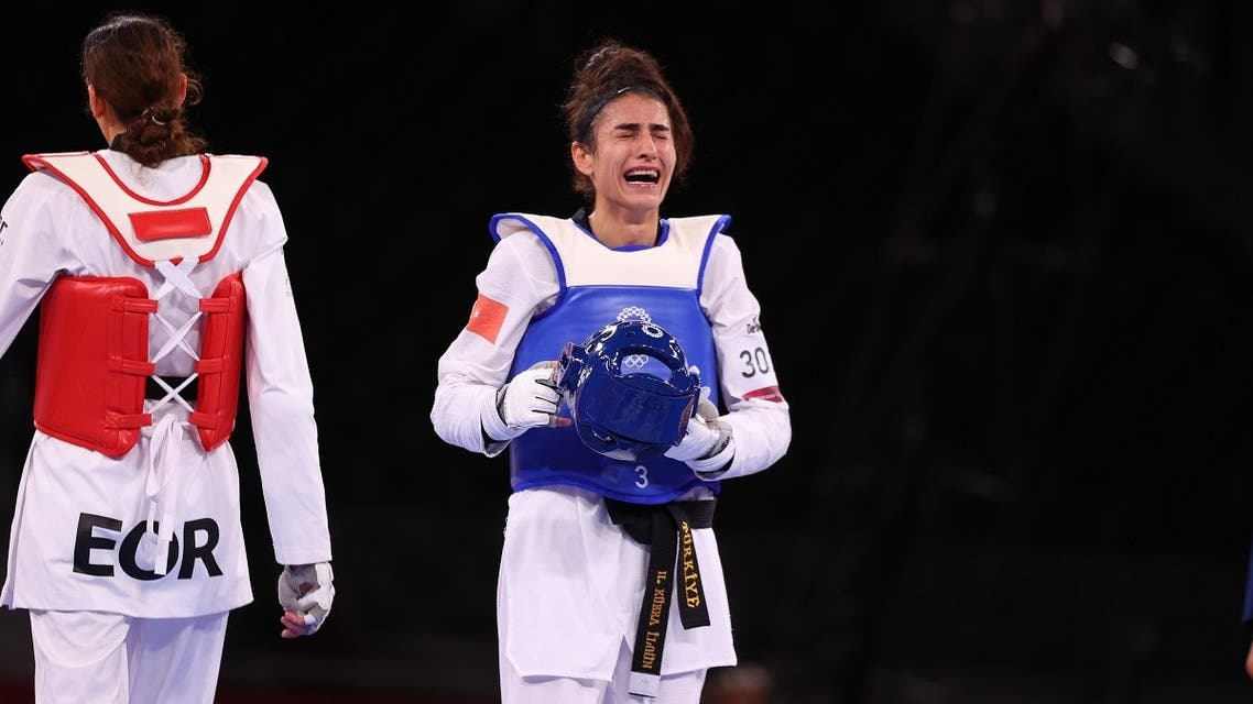 Kimia Alizadeh of the Refugee Olympic Team and Hatice Kubra Ilgun of Turkey react after competing. (Reuters)