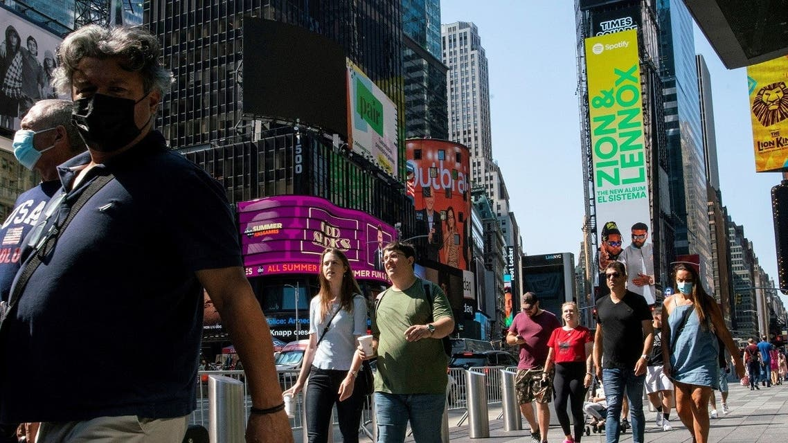 People wear masks around Times Square, as cases of the infectious coronavirus Delta variant continue to rise in New York City, July 23, 2021. (Reuters)