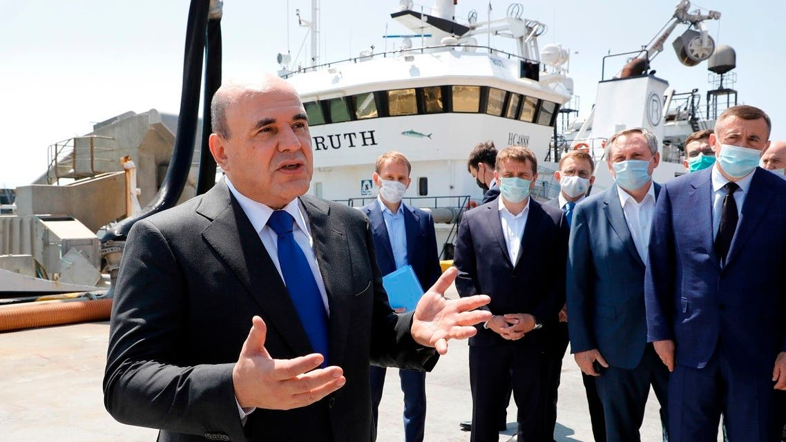 Russian Prime Minister Mikhail Mishustin visits the Gidrostroi's fish processing plant, on the disputed Pacific islands claimed by Japan, known by the Russians as the Kuril Islands and the Japanese as the Northern Territories, on July 26, 2021.  (AP)