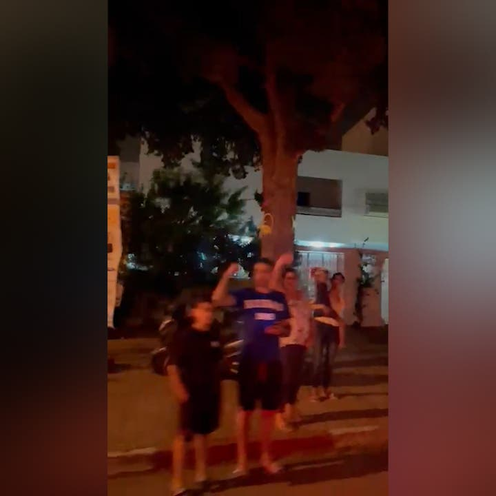 Watch: Tunisians celebrate after protests result in parliament suspension, PM removal