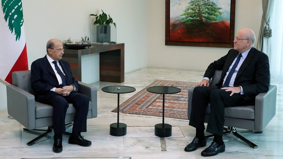 Lebanon's President Michel Aoun (L) meeting with two-time premier Najib Mikati at the presidential palace in Baabda, east of the capital Beirut on July 26, 2021. (stringer/Dalati and Nohra/AFP)