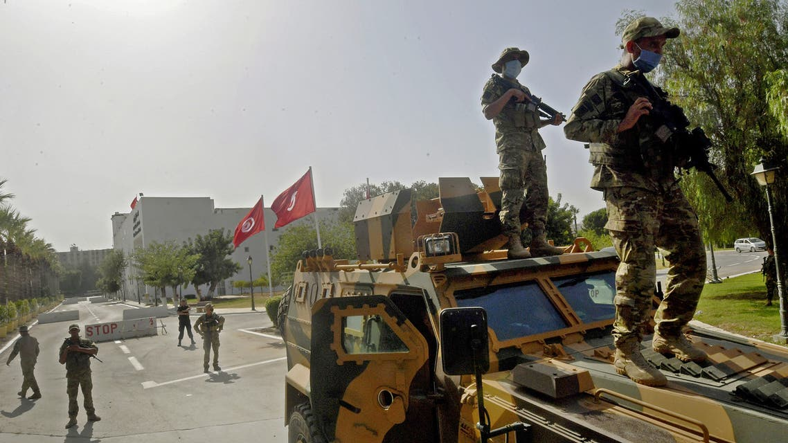 Tunisian military forces guard the area around the parliament building in the capital Tunis on July 26, 2021, following protests in reaction to a move by the president last night to suspend the north African country's parliament and dismiss the Prime Minister. Tunisia was plunged deeper into crisis as President Kais Saied suspended parliament and dismissed Prime Minister Hichem Mechichi late July 25, prompting the country's biggest political party to decry a coup d'etat.