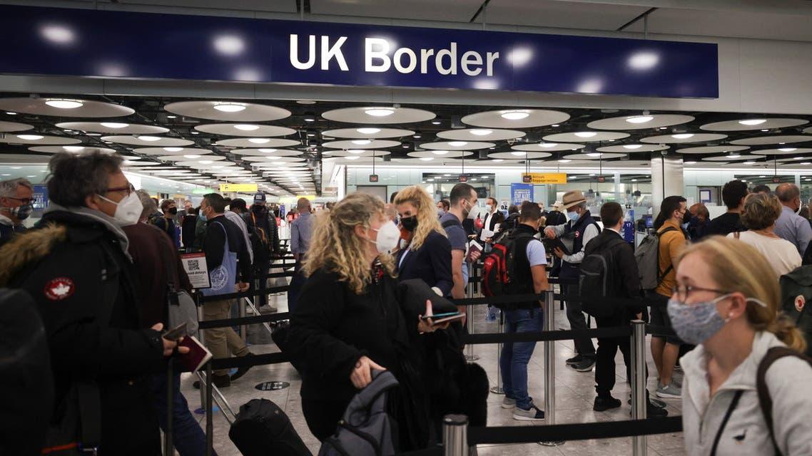 Arriving passengers queue at UK Border Control at the Terminal 5 at Heathrow Airport in London, Britain June 29, 2021. (Reuters)
