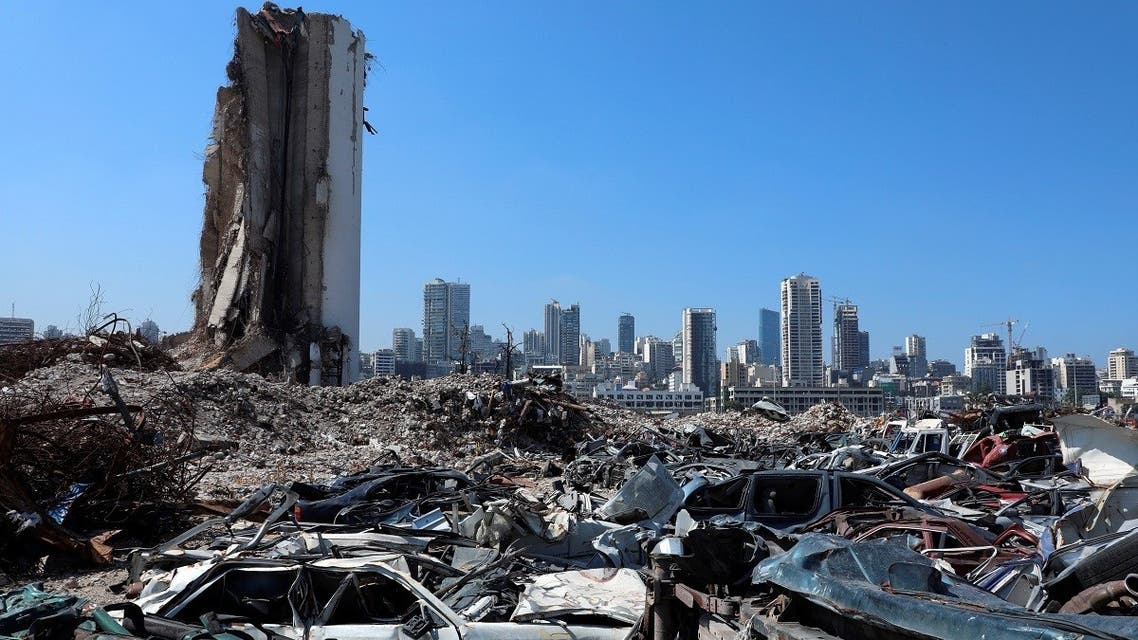 The wreckage of vehicles are pictured near Beirut's destroyed grain silo at the site of the August 4, 2020 explosion at Beirut port, July 13, 2021. (Reuters)