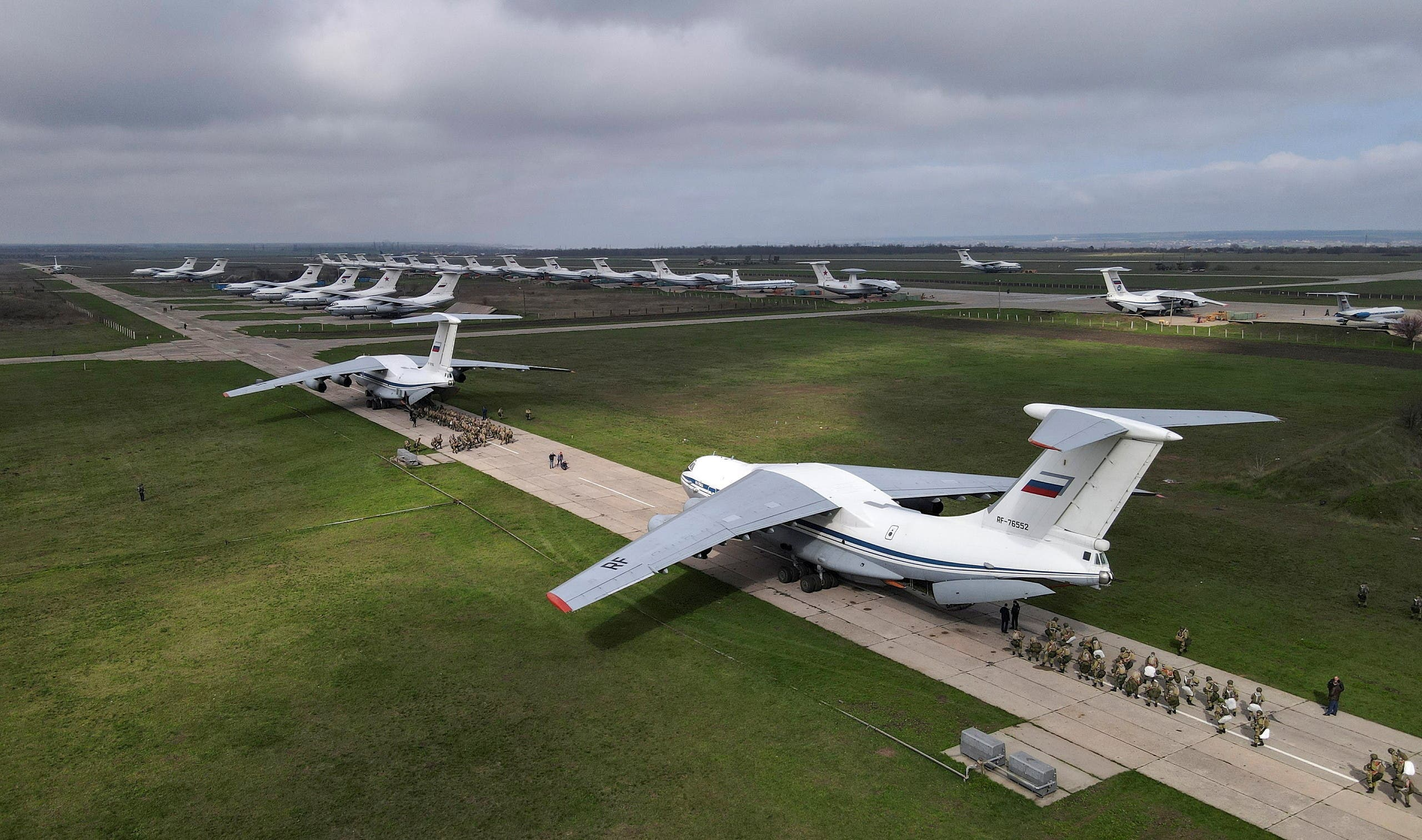 Service members of the Russian airborne forces board Ilyushin Il-76 transport planes during drills at a military aerodrome in the Azov Sea port of Taganrog, Russia April 22, 2021. Picture taken with a drone. (File photo: Reuters)