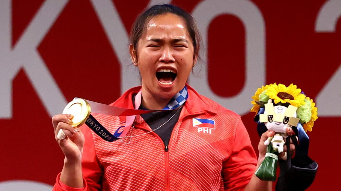 Tokyo 2020 Olympics - Weightlifting - Women's 55kg - Medal Ceremony - Tokyo International Forum, Tokyo, Japan - July 26, 2021. Gold medalist Hidilyn Diaz of the Philippines reacts. (Reuters)