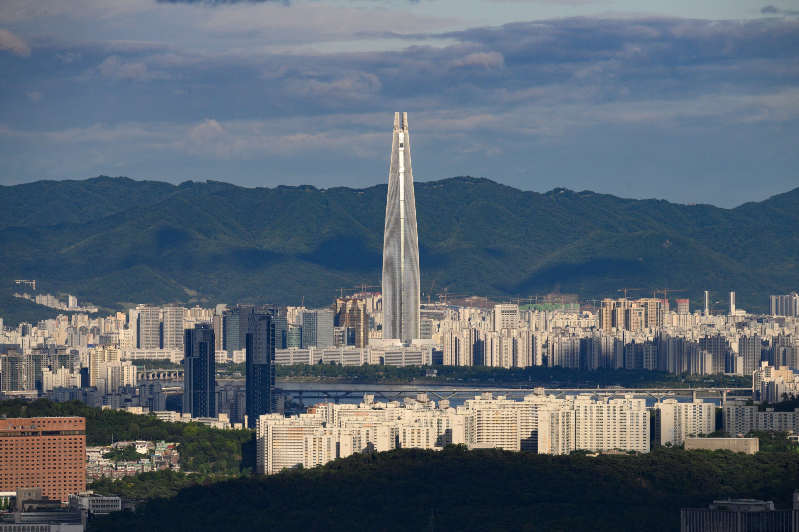 A photo taken on June 7, 2019 shows a general view of the Seoul city skyline and landmark Lotte tower. (AFP)