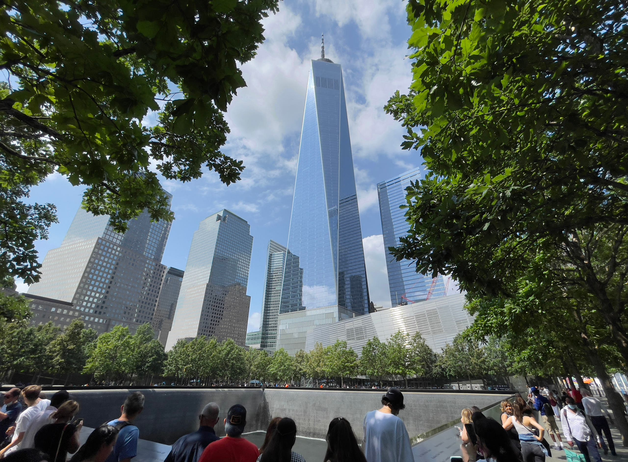 One World Trade Center building is seen as people visit the 9/11 memorial in New York on July 18, 2021. (AFP)
