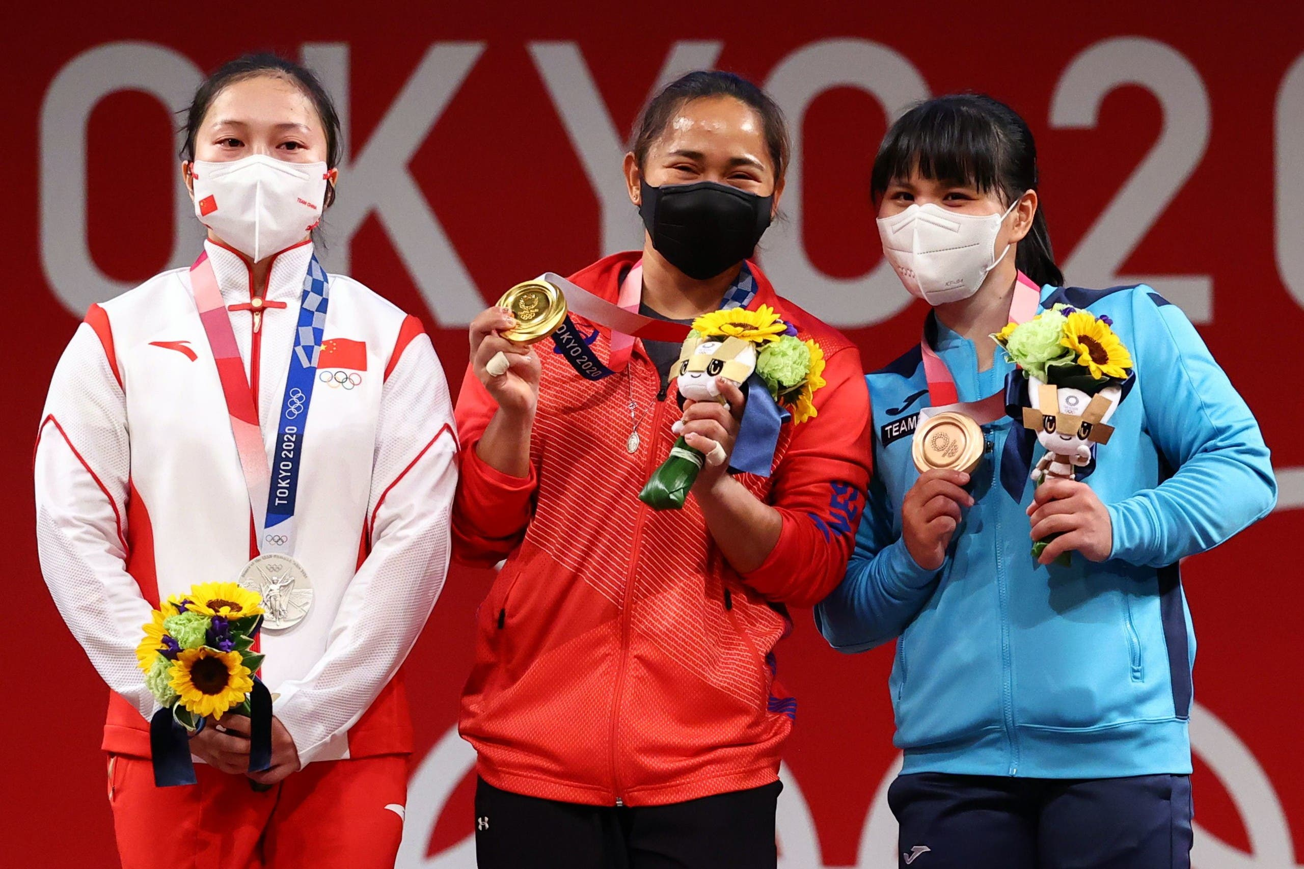 Tokyo 2020 Olympics - Weightlifting - Women's 55kg - Medal Ceremony - Tokyo International Forum, Tokyo, Japan - July 26, 2021. Gold medalist Hidilyn Diaz of the Philippines, silver medalist Liao Qiuyun of China and bronze medalist Zulfiya Chinshanlo of Kazakhstan pose. (Reuters)