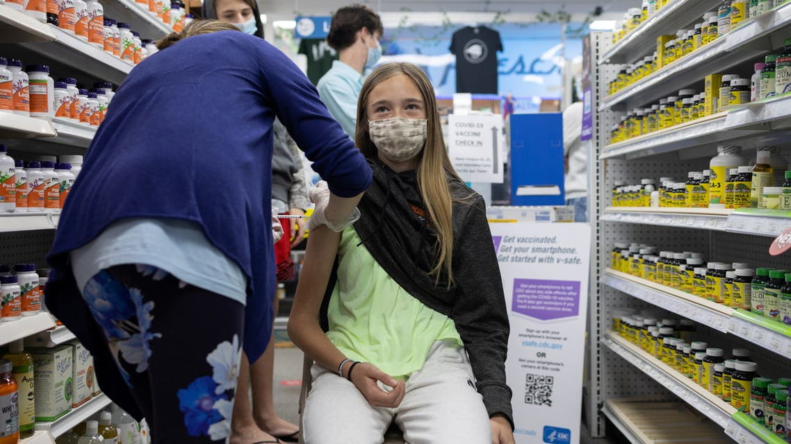 Abby Oplinger, 13, receives the Pfizer-BioNTech coronavirus disease (COVID-19) vaccine after Pennsylvania authorized the vaccine for those over 12-years-old at Skippack Pharmacy in Schwenksville, Pennsylvania, US, May 12, 2021. (Reuters)