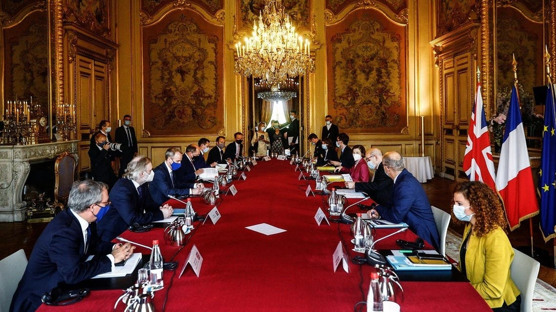 Britain's Foreign Secretary Dominic Raab (3rdL), Britain's Defense Secretary Ben Wallace (4thL), French FM Jean-Yves Le Drian (3rdR), and French Defense Minister Florence Parly (4thR) attend a meeting in Paris on July 26, 2021. (Sameer Al-Doumy/AFP)