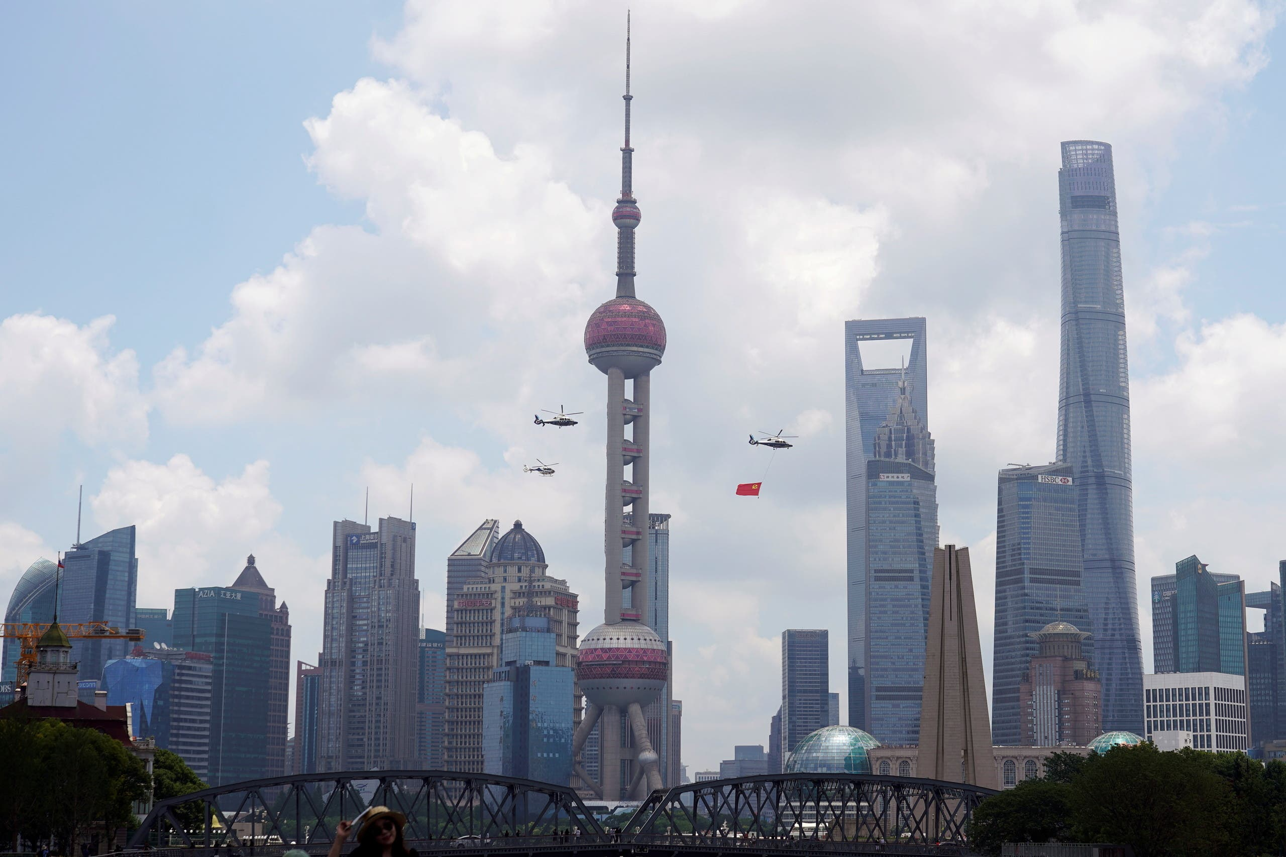 Aircraft fly in formation past Oriental Pearl Tower at Lujiazui financial district of Pudong on the 100th founding anniversary of the Communist Party of China, in Shanghai, China July 1, 2021. (Reuters)