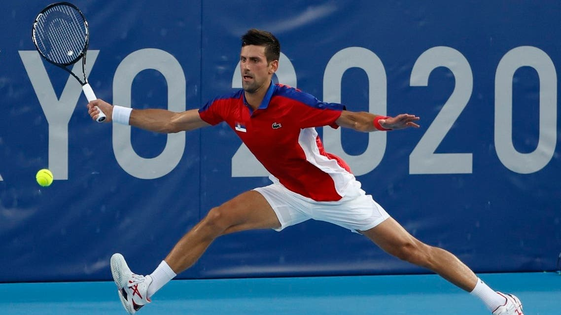 Novak Djokovic of Serbia reaches for a forehand against Alejandro Davidovich Fokina of Spain (not pictured) in a mens' singles round of sixteen match during the Tokyo 2020 Olympic Summer Games at Ariake Tennis Park Tokyo, Japan, on July 28, 2021. (Reuters)