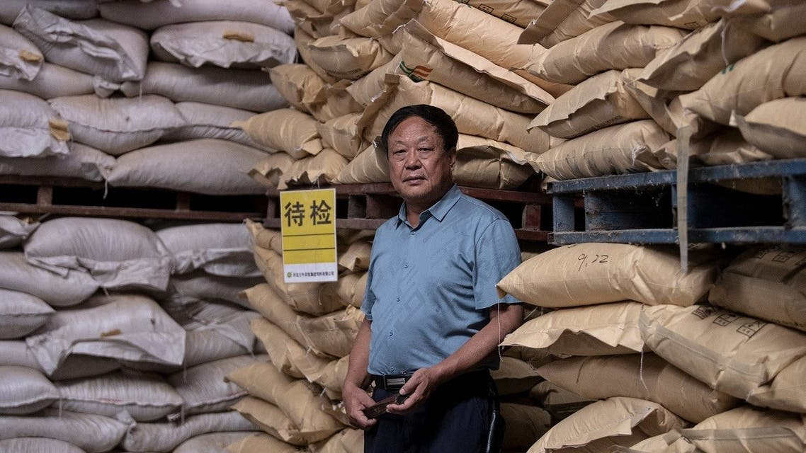 This file photo taken on September 24, 2019, shows Chinese farmer and billionaire Sun Dawu posing at a feed warehouse in Hebei, outside Beijing. (AFP)
