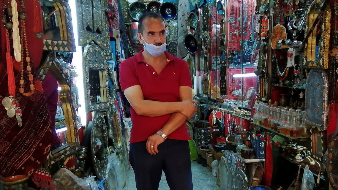 Abdesattar Massoudi, the owner of an artisanal store, attends an interview with Reuters inside his shop in the tourist bazaar in the Old City of Tunis, Tunisia July 27, 2021. (Reuters)