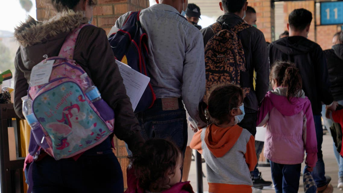 Central American children walk in line with their parents after being dropped off by Border Patrol at the bus station in Brownsville, Texas, U.S. March 15, 2021. Picture taken March 15, 2021. (File Photo: Reuters)