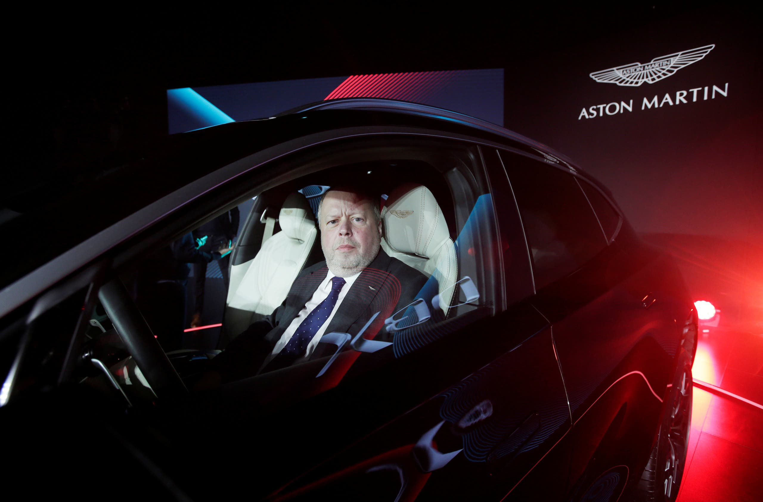CEO of Aston Martin Andy Palmer poses for a photo inside the company's first sport utility vehicle Aston Martin DBX in Beijing, China November 20, 2019. (Reuters)