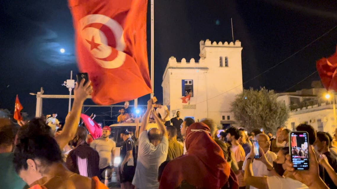 Crowds gather on the street after Tunisia's president suspended parliament, in La Marsa, near Tunis, Tunisia July 26, 2021, in this still image obtained from a social media video. (Reuters)