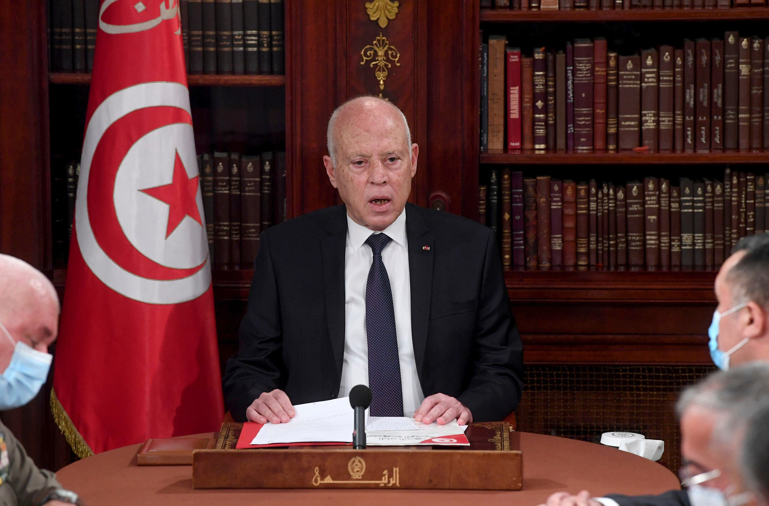 Tunisia's President Kais Saied, center, leads a security meeting with members of the army and police forces in Tunis, Tunisia, Sunday, July 25, 2021. (AP)