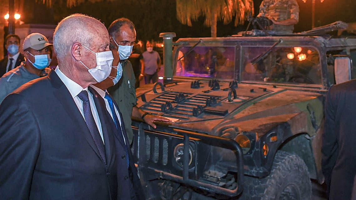 Tunisian President Kais Saied gesturing as he enters a vehicle in Tunis's central Habib Bourguiba Avenue, July 26, 2021. (Tunisian Presidency Facebook)