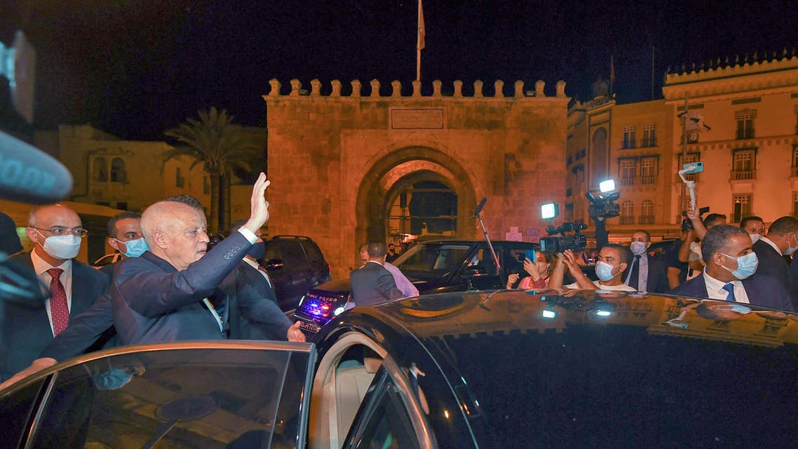 A handout picture provided by the Tunisian Presidency Facebook Page on July 26, 2021 shows Tunisian President Kais Saied gesturing as he enters a vehicle in Tunis's central Habib Bourguiba Avenue, after he ousted the prime minister and ordered parliament closed for 30 days. (AFP)