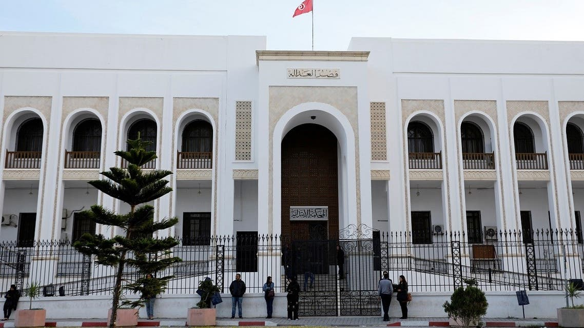 People stand outside a closed court during a nationwide strike in Tunis, Tunisia November 22, 2018. (Reuters)
