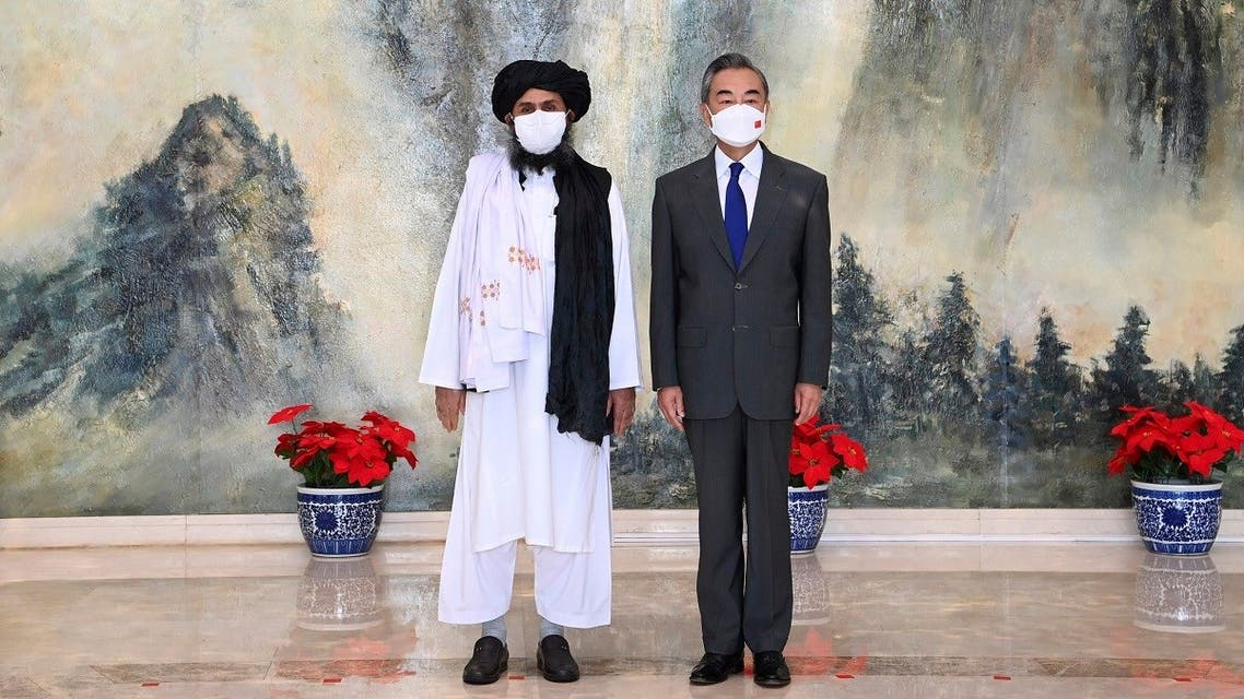 Taliban co-founder Mullah Abdul Ghani Baradar, left, and Chinese Foreign Minister Wang Yi pose for a photo during their meeting in Tianjin, China, on July 28, 2021. (AP)
