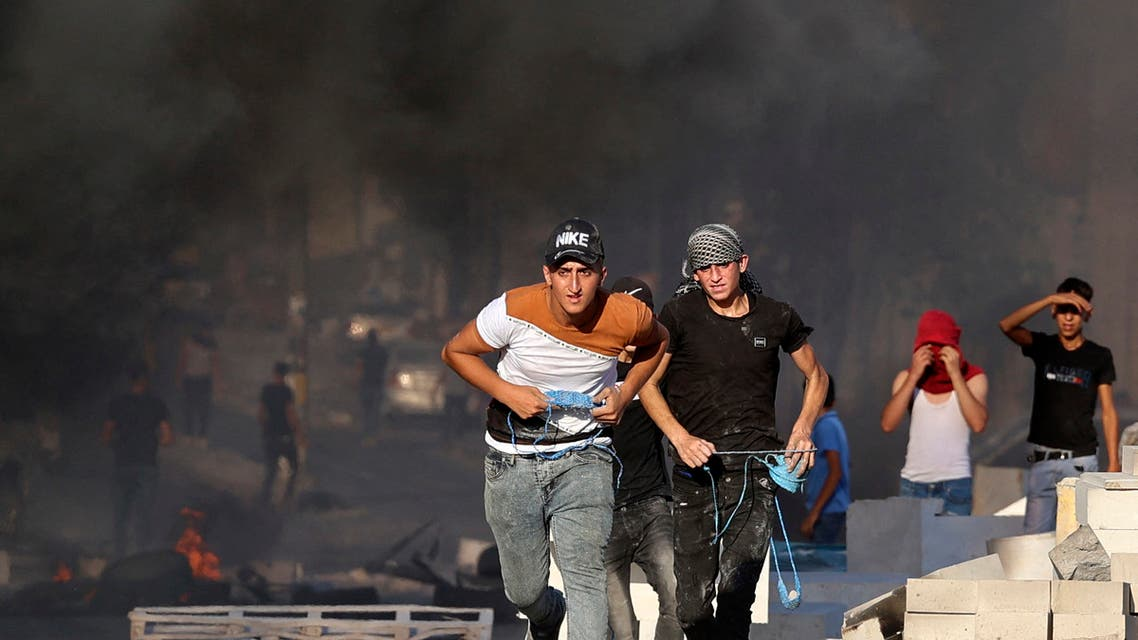 Palestinian demonstrators clash with Israeli soldiers as they demand that the army hands over the body of man who was shot dead by Israeli forces the previous night, in the village of Beita, in the occupied West Bank, on July 28, 2021. (File photo: AFP)