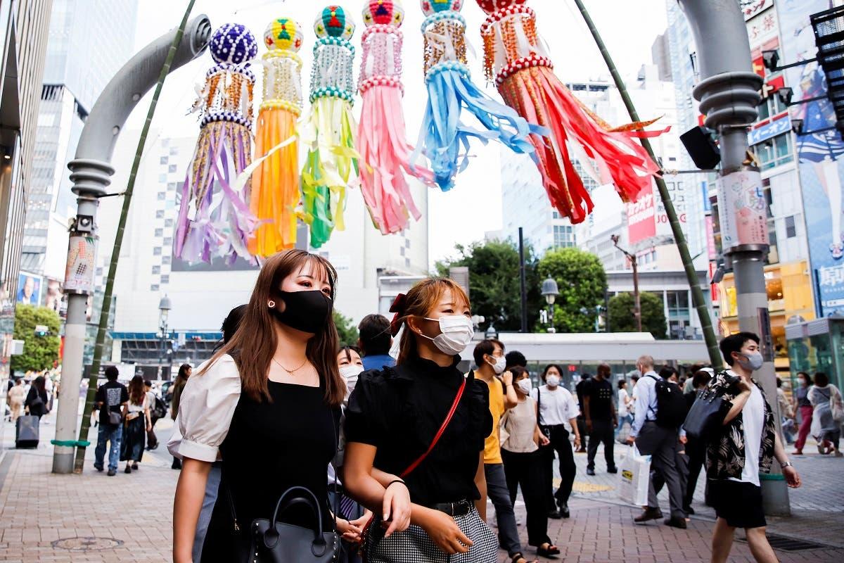 People walk in Shibuya area of Tokyo, Japan, on July 29, 2021. (Reuters)