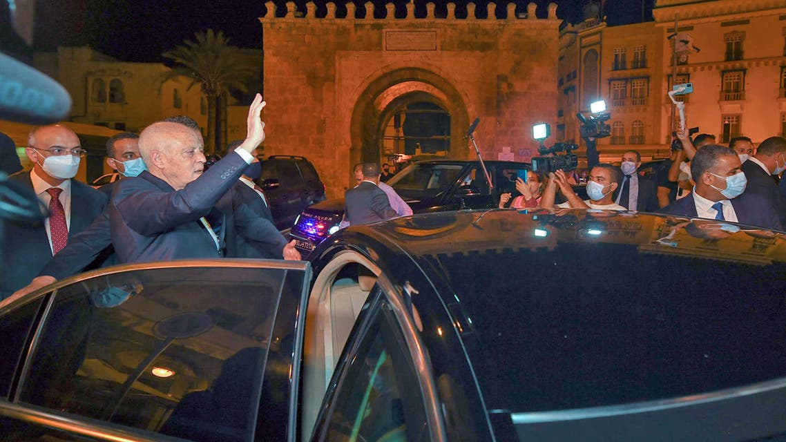 A handout picture provided by the Tunisian Presidency Facebook Page on July 26, 2021 shows Tunisian President Kais Saied gesturing as he enters a vehicle in Tunis's central Habib Bourguiba Avenue, after he ousted the prime minister and ordered parliament closed for 30 days. Tunisia was plunged deeper into crisis as Saied suspended parliament and dismissed Prime Minister Hichem Mechichi late July 25, prompting the country's biggest political party to decry a coup d'etat
