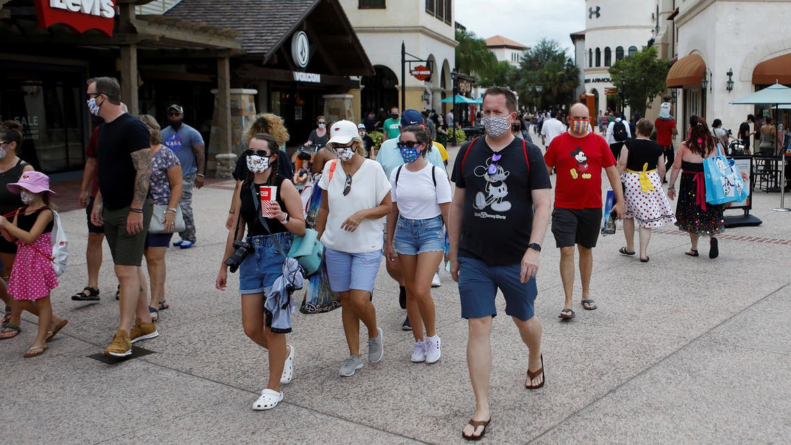 Disney Springs shoppers wear face masks and at Walt Disney World in Florida, July 11, 2020. (Reuters)