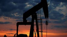 Oil edges higher on falling US inventory with, Brent topping $75 a barrel