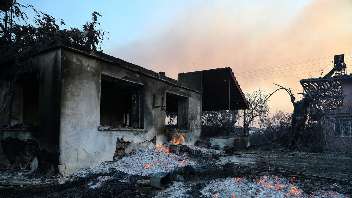 A burnt house is seen as a massive forest fire spread to the town of Manavgat, 75 km (45 miles) east of the resort city of Antalya, Turkey, July 28, 2021. (Reuters)