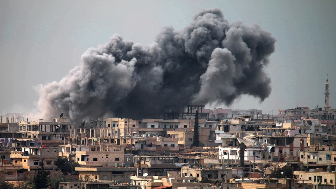 In this file photo taken on March 16, 2017 smoke billows following reported air strikes on a opposition-held area in the southern city of Daraa. (AFP)