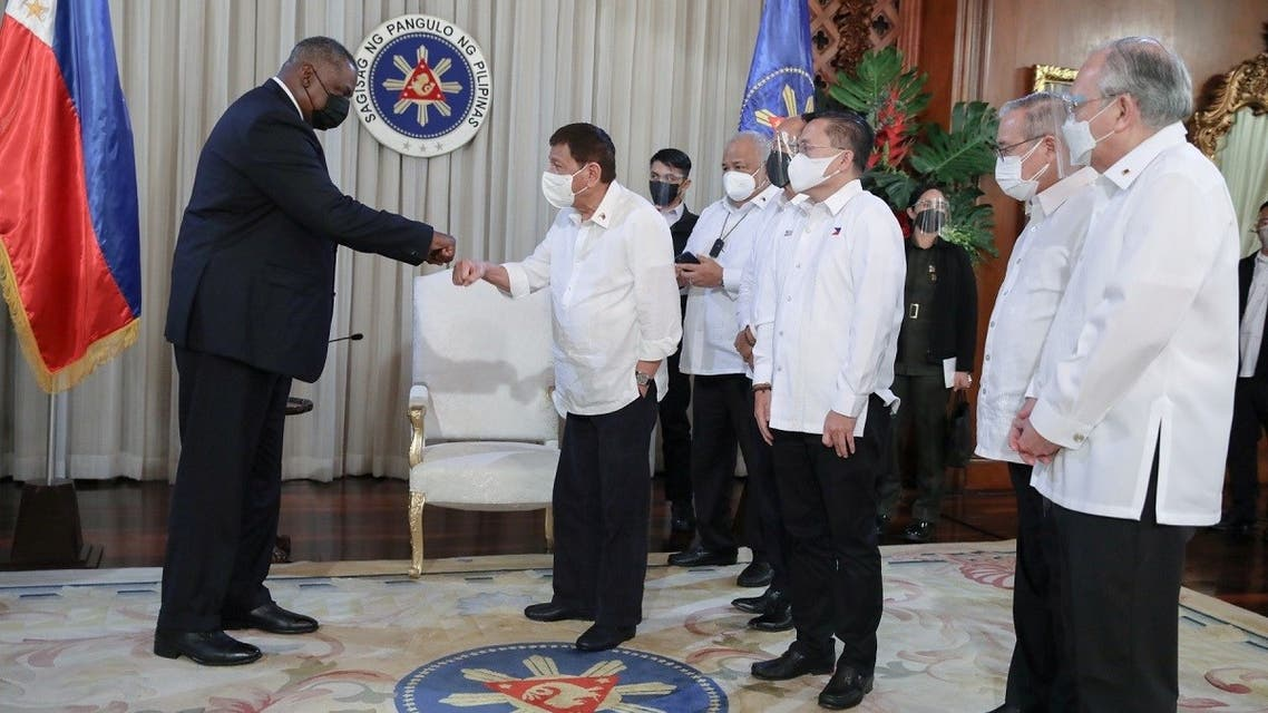 US Secretary of Defense Lloyd Austin fist bumps with Philippine President Rodrigo Duterte during a courtesy call at the Malacanang Palace in Manila, Philippines, on July 29, 2021. (Reuters)