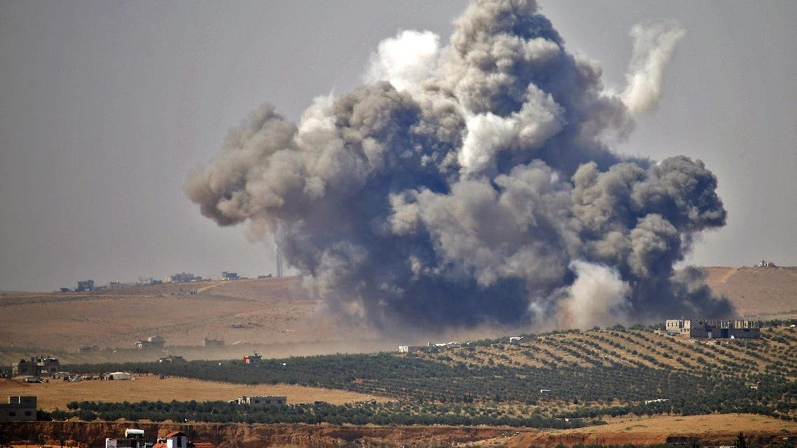 Smoke rises above rebel-held areas of the city of Daraa, during reported airstrikes by Syrian regime forces. (File Photo: AFP)