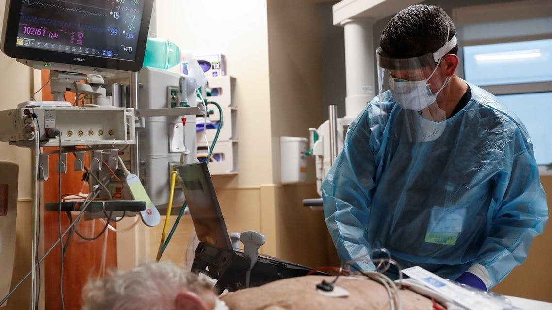 A critical care respiratory therapist works with a coronavirus disease positive patient in the intensive care unit (ICU) at Sarasota Memorial Hospital in Sarasota, Florida. (File Photo: Reuters)