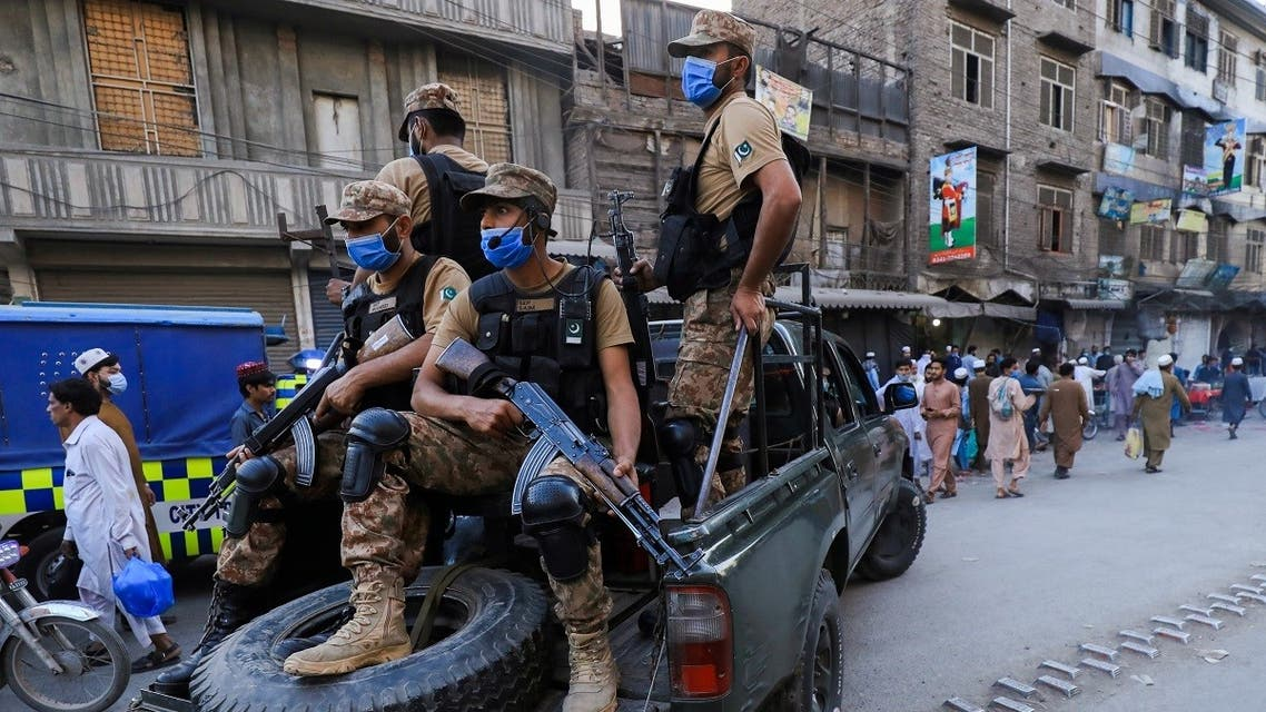 Army soldiers patrol the street, to enforce coronavirus safety protocols, as the spread of the coronavirus continues in Peshawar, Pakistan. (Reuters)