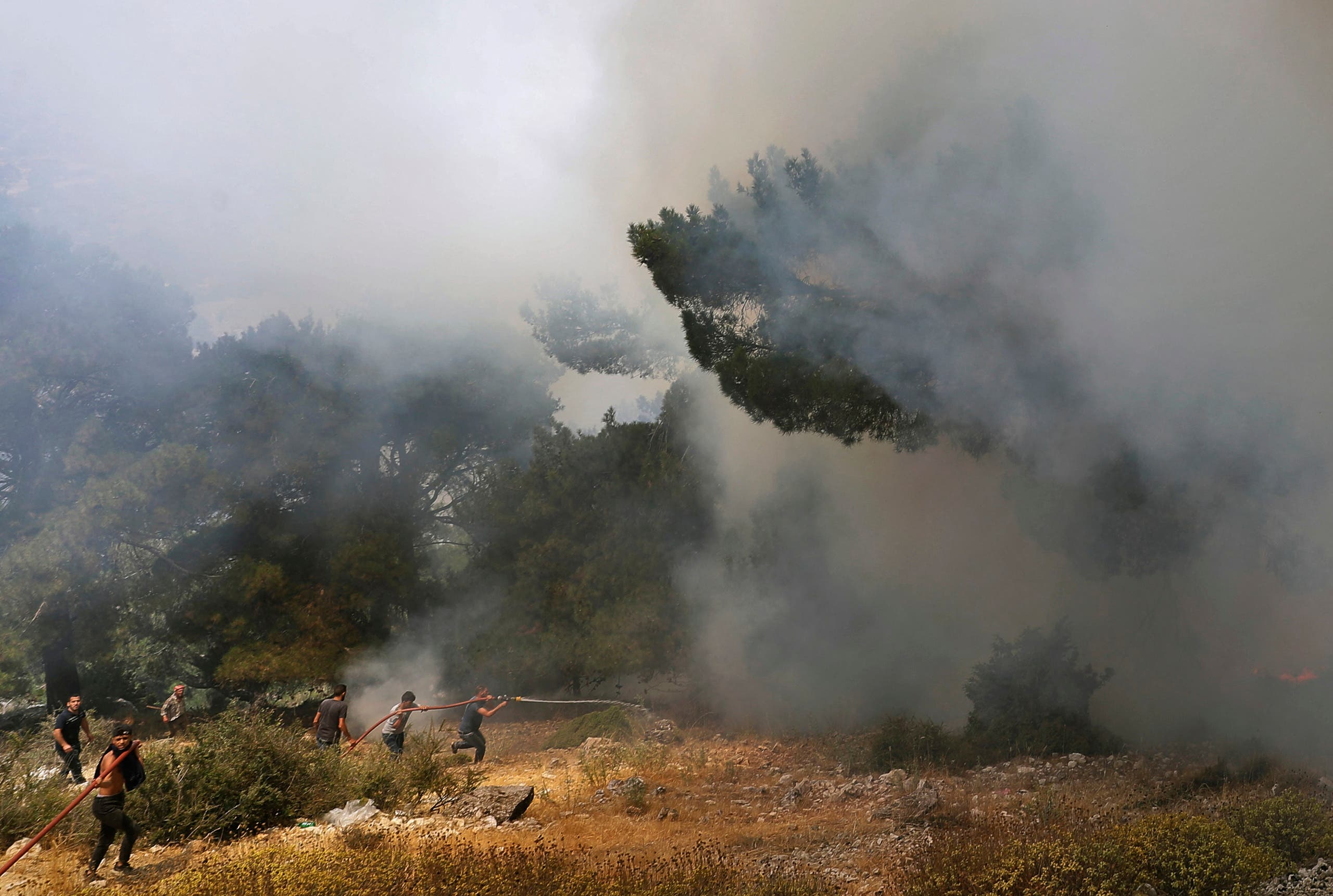 The Civil Defense tries to put out the fires
