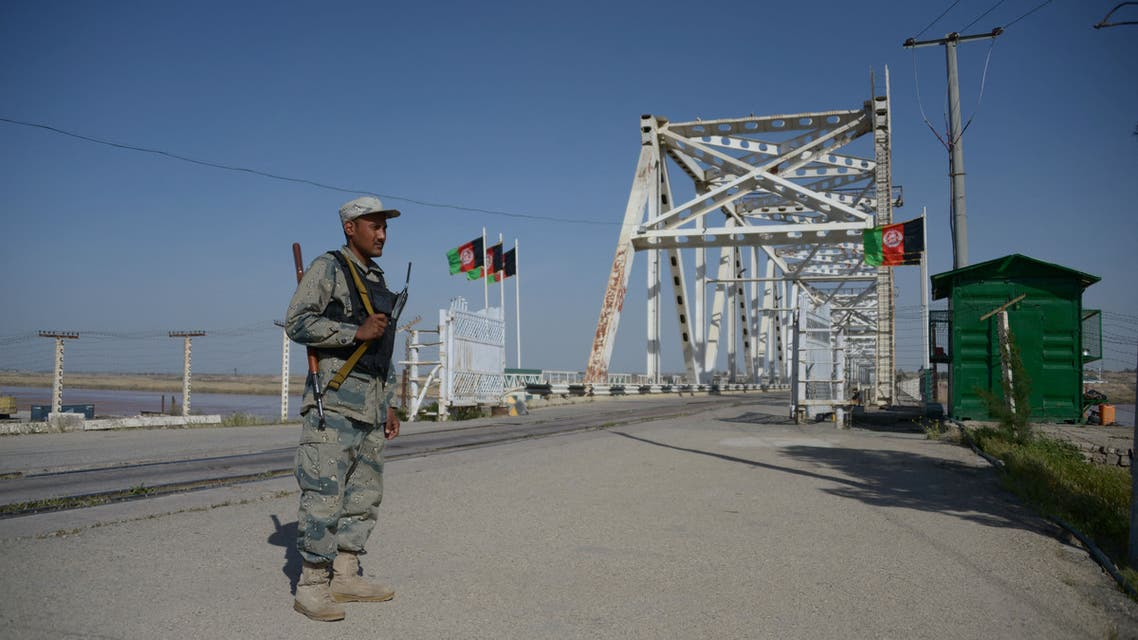 In this photograph taken on March 20, 2016, Afghan border police personnel stand guard on the Afghan side of the Afghanistan–Uzbekistan bridge in Hairatan.