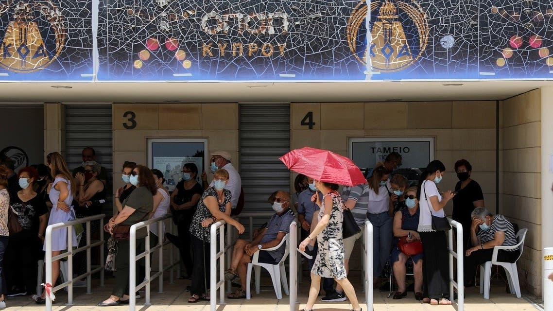 People wait outside a vaccination center, amid the coronavirus disease pandemic in Limassol, Cyprus, May 4, 2021. (Reuters)