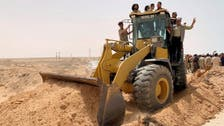 Libya's combatants declare key coast road open, but not to military traffic