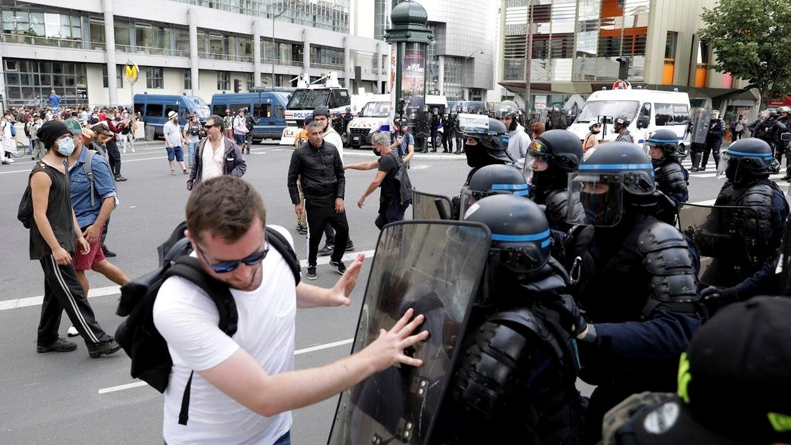 A protestor pushes on the shield of a police officer during a demonstration in Paris, France, on July 31, 2021. (AP)